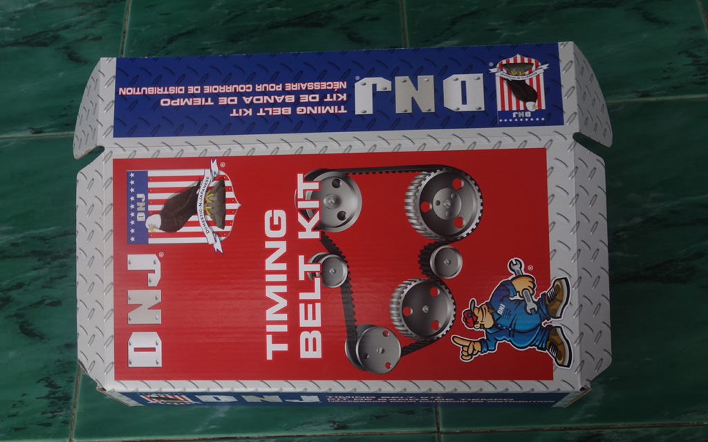 E flute corrugated box with paperboard insert