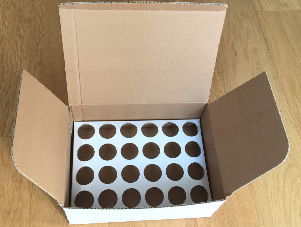 corrugated insert with round cuts or holes